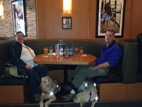 Denise and Wil enjoy Blue Moons while Penny and Chip rest under the table.
