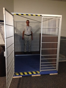 Wil stands in the back of Leader Dog's large and spacious future kennel suite.