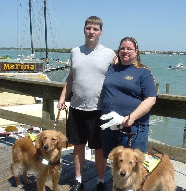 Wil, Denise, Max, and Titan enjoy the fresh air on boardwalk at John's Pass, FL on 4/11/05.